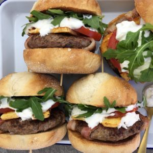 Lamb burgers with bacon & yoghurt dressing - lightly spiced lamb patties wrapped in bacon dripping in a zingy yoghurt sauce