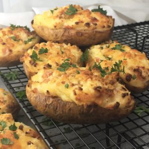 Stuffed baked potatoes with bacon - light fluffy centres of potato, cheese & bacon - need I say more...
