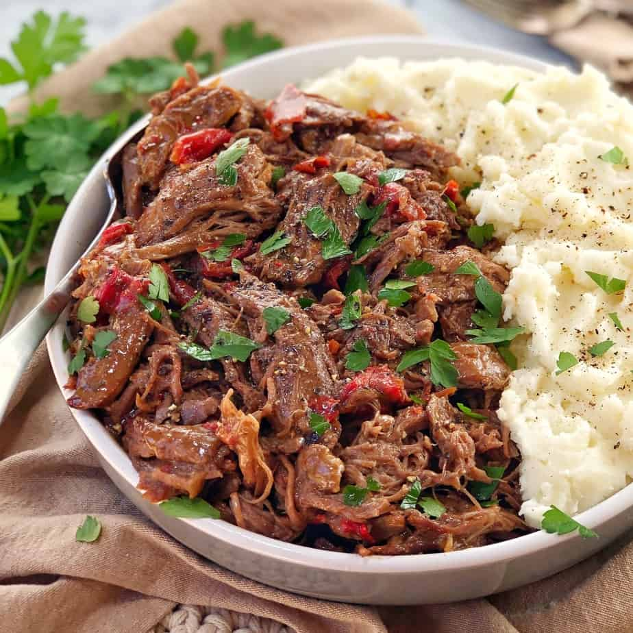 shredded lamb and mashed potato in a white bowl