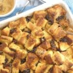 golden cubes of bread with raisins in a white baking dish