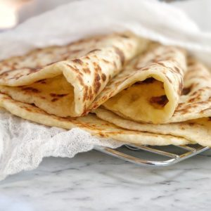 folded flatbread on a wire rack