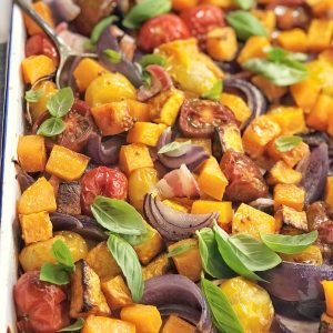 mixed vegetables on a white baking tray