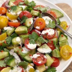 cucumber tomato avocado salad with sour cream dressing