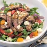 Warm Lamb Salad with Pumpkin Tomato & Feta - a warm salad of spice rubbed pan fried lamb leg steaks with oven baked vegetables, topped with a lemon mustard dressing and crumbled feta