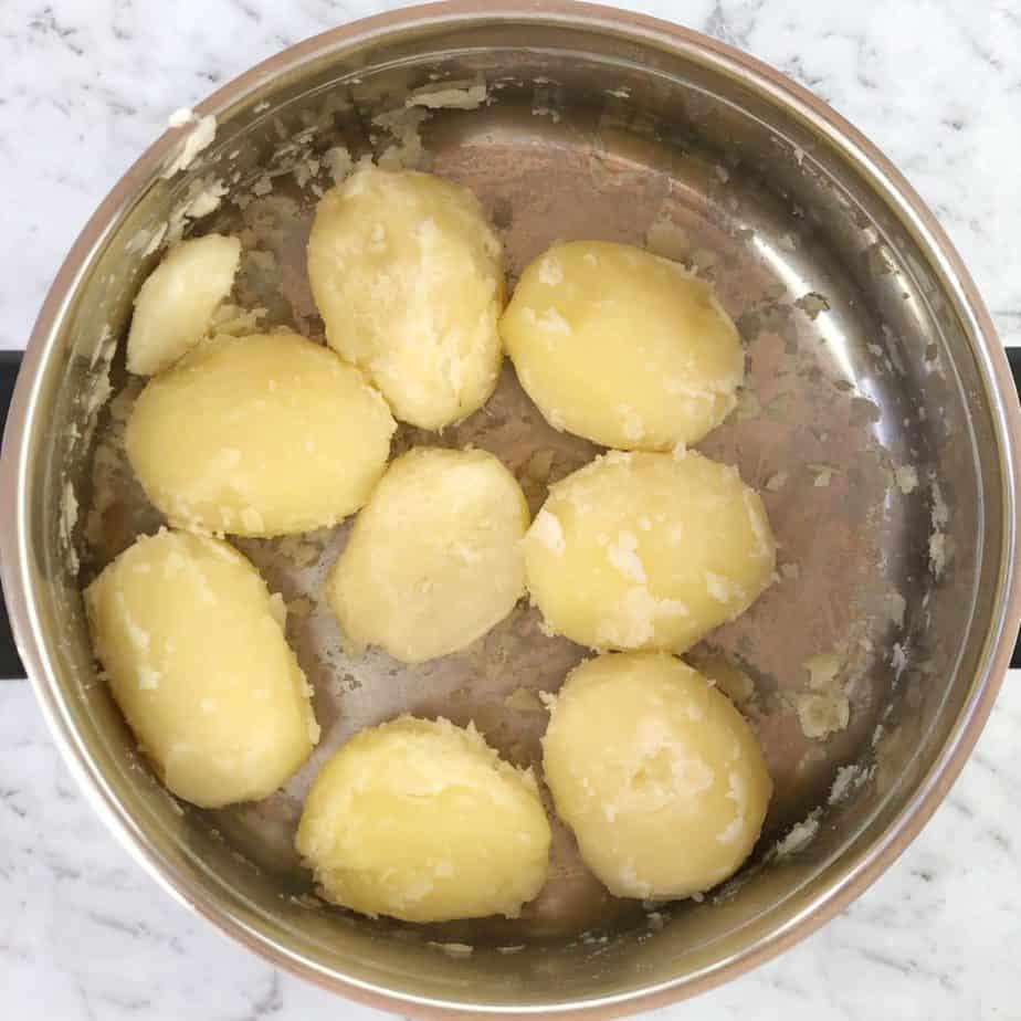 boiled potatoes in steel pot