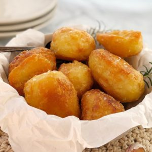 golden roast potatoes in a a bowl
