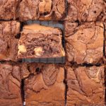 tray of brownie slices with one on edge