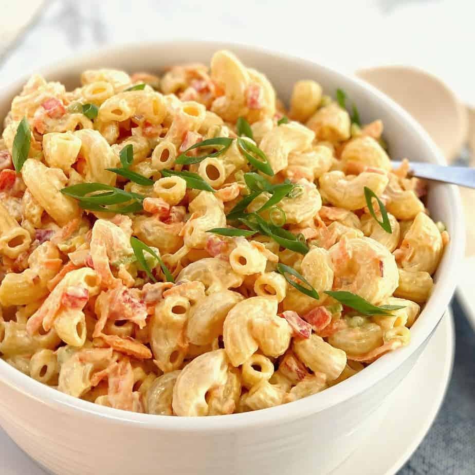 creamy pasta salad in a white bowl