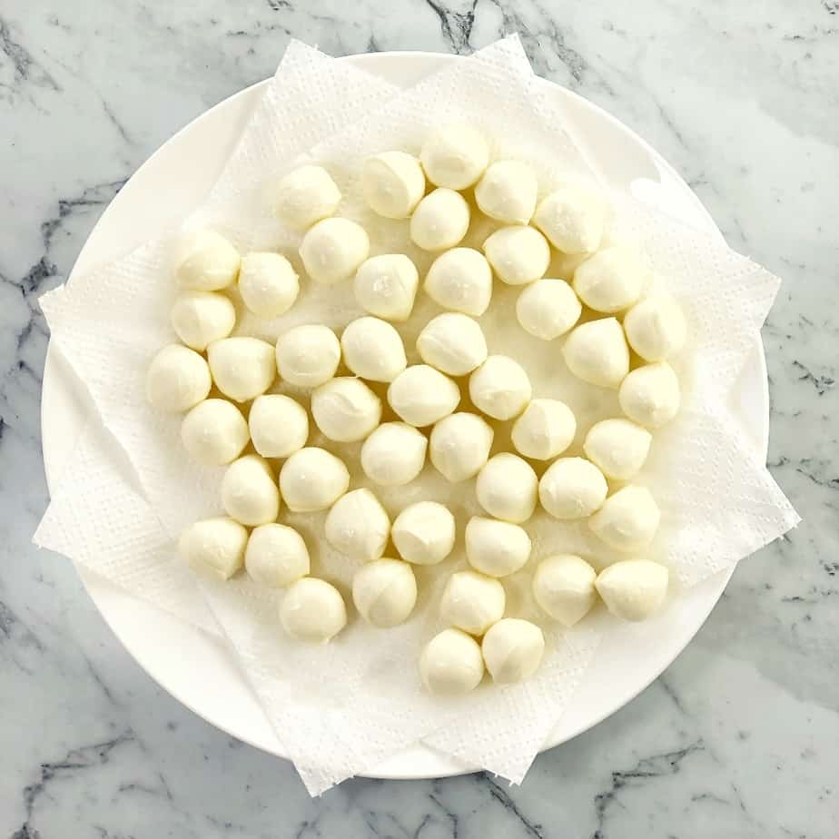 process shot showing how to make marinated mozzarella balls