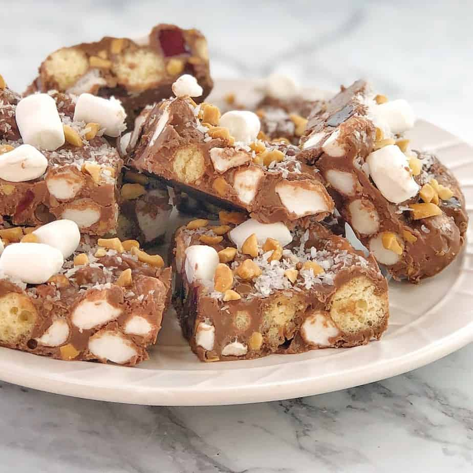 rocky road with maltesers and marshmallows on a white plate