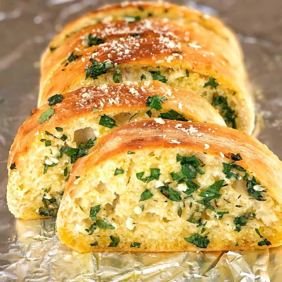 baked bread slices with herbs and garlic