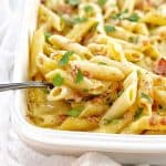 penne pasta with creamy sauce in a white baking dish