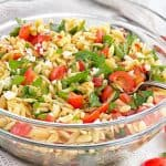 pasta tomatoes and herbs in a glass bowl