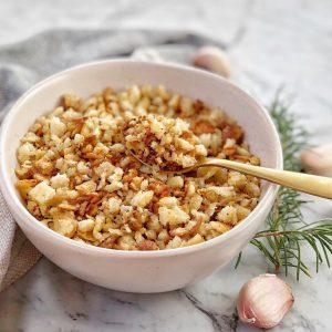 crisp breadcrumbs in a white bowl