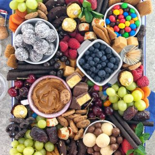 collection of chocolates fruit and sweets on a white baking tray