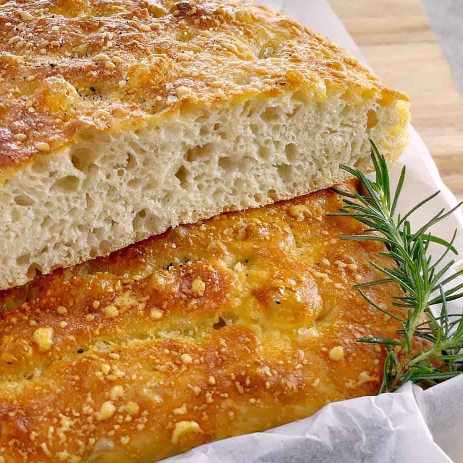 slices of focaccia in baking tray on a bread board